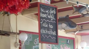 "Great sign in the bar: ""No, we don't have wi-fi. Talk to each other."""